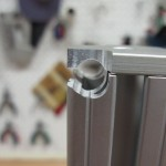 Milled slot to pick up tie-down bracket